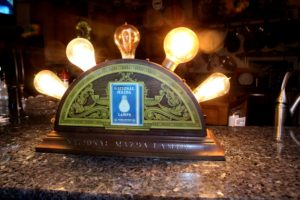 "Small version of a Mazda Light Bulb Display..Very Old & excllent..""in our collection"""
