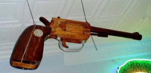Great Old Original Trade Sign in the form of a Pistol..Approx. 6' long, with old Patina  $10,500